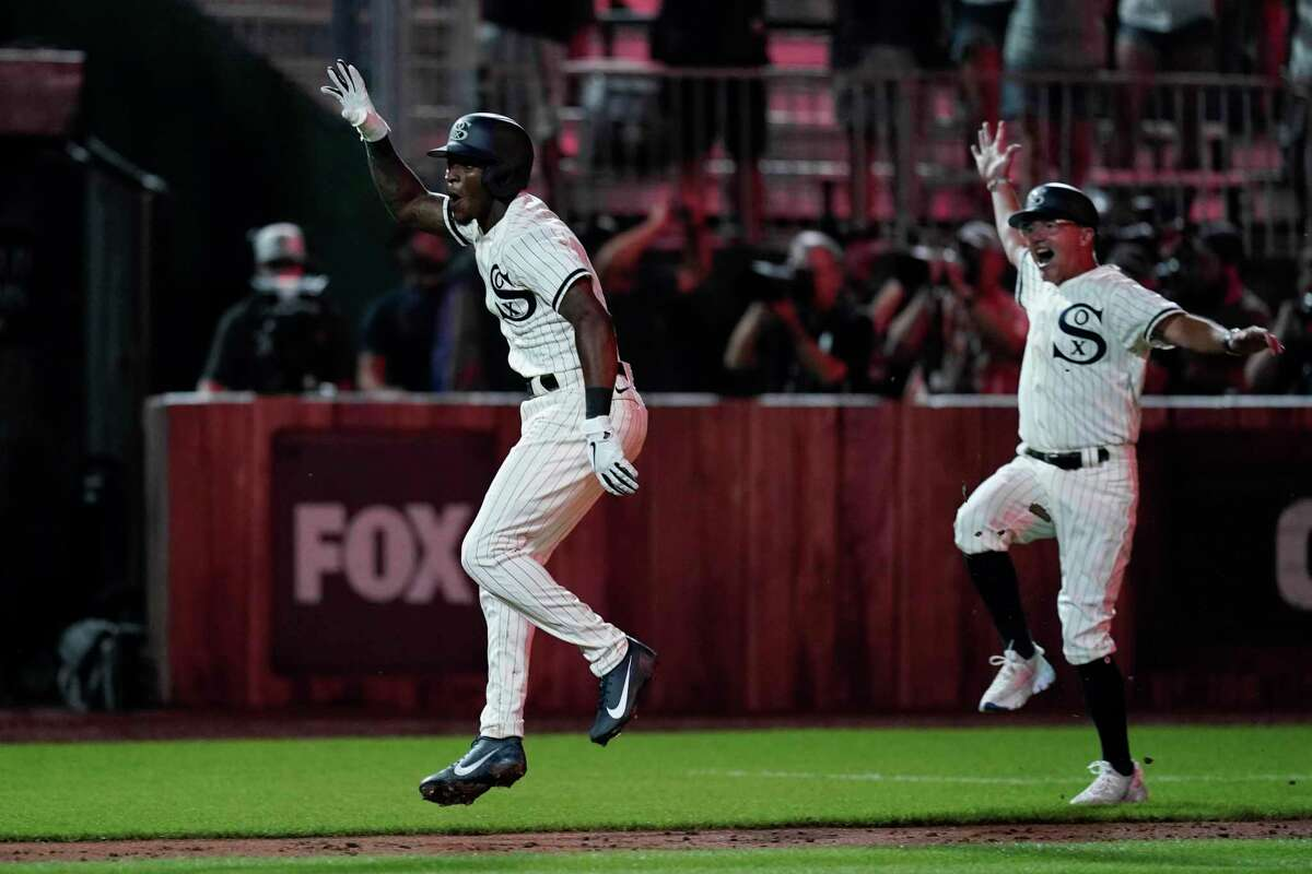 Chicago White Sox's Tim Anderson, left, celebrates his walk-off home run against the New York Yankees in the ninth inning during a baseball game, Thursday, Aug. 12, 2021 in Dyersville, Iowa. The Yankees and White Sox are playing at a temporary stadium in the middle of a cornfield at the Field of Dreams movie site, the first Major League Baseball game held in Iowa. The White Sox won 9-8. (AP Photo/Charlie Neibergall)