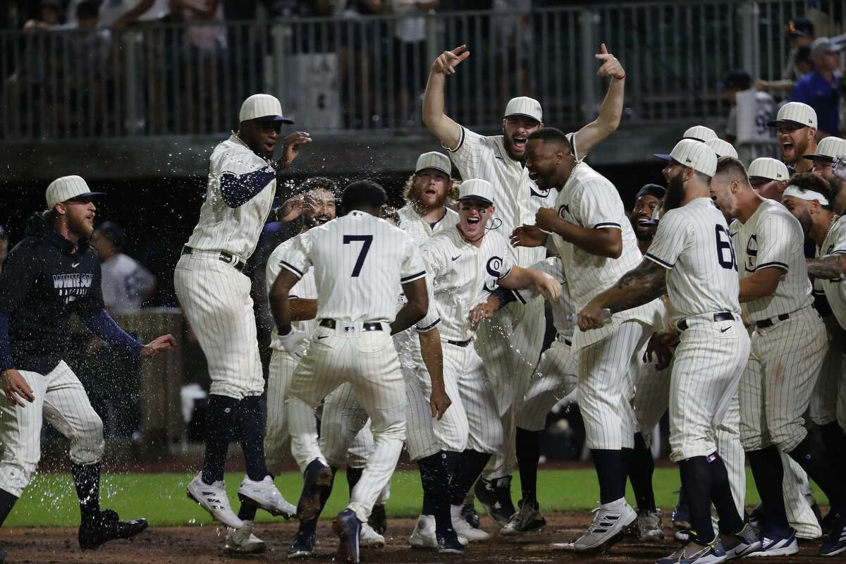 The Chicago White Sox' Tim Anderson (7) hits a walk-off two-run home run to beat the New York Yankees in the ninth inning at the Field of Dreams game in Dyersville, Iowa, on Thursday, Aug. 12, 2021. The White Sox won, 9-8. (Jose M. Osorio/Chicago Tribune/TNS)