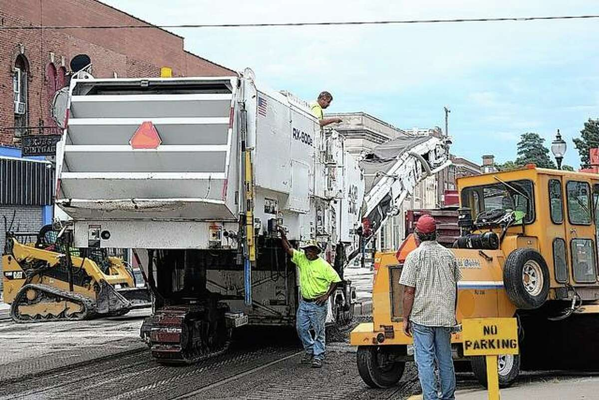 City of Jacksonville crews work Thursday on resufacing East State Street as part of a renovation project for the street.