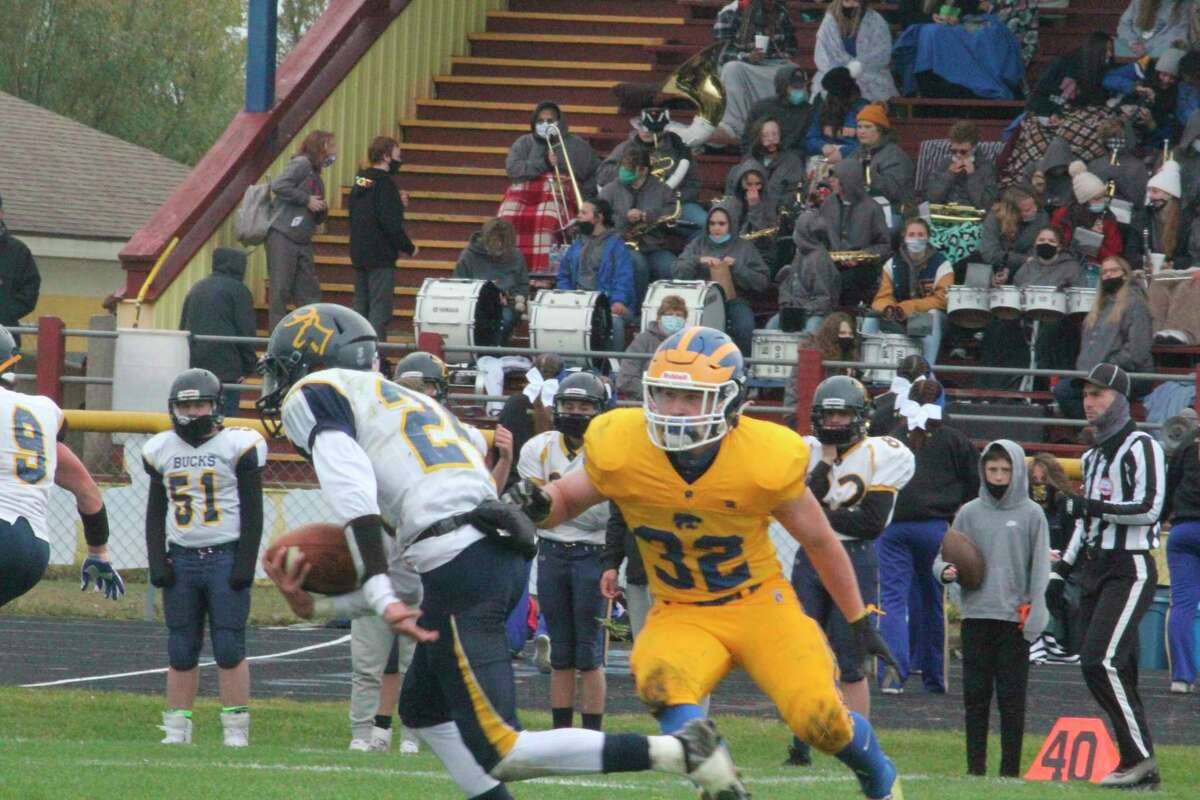 Cole Hopkins (32) works to make the play for Evart during the 2020 season. (Pioneer file photo)