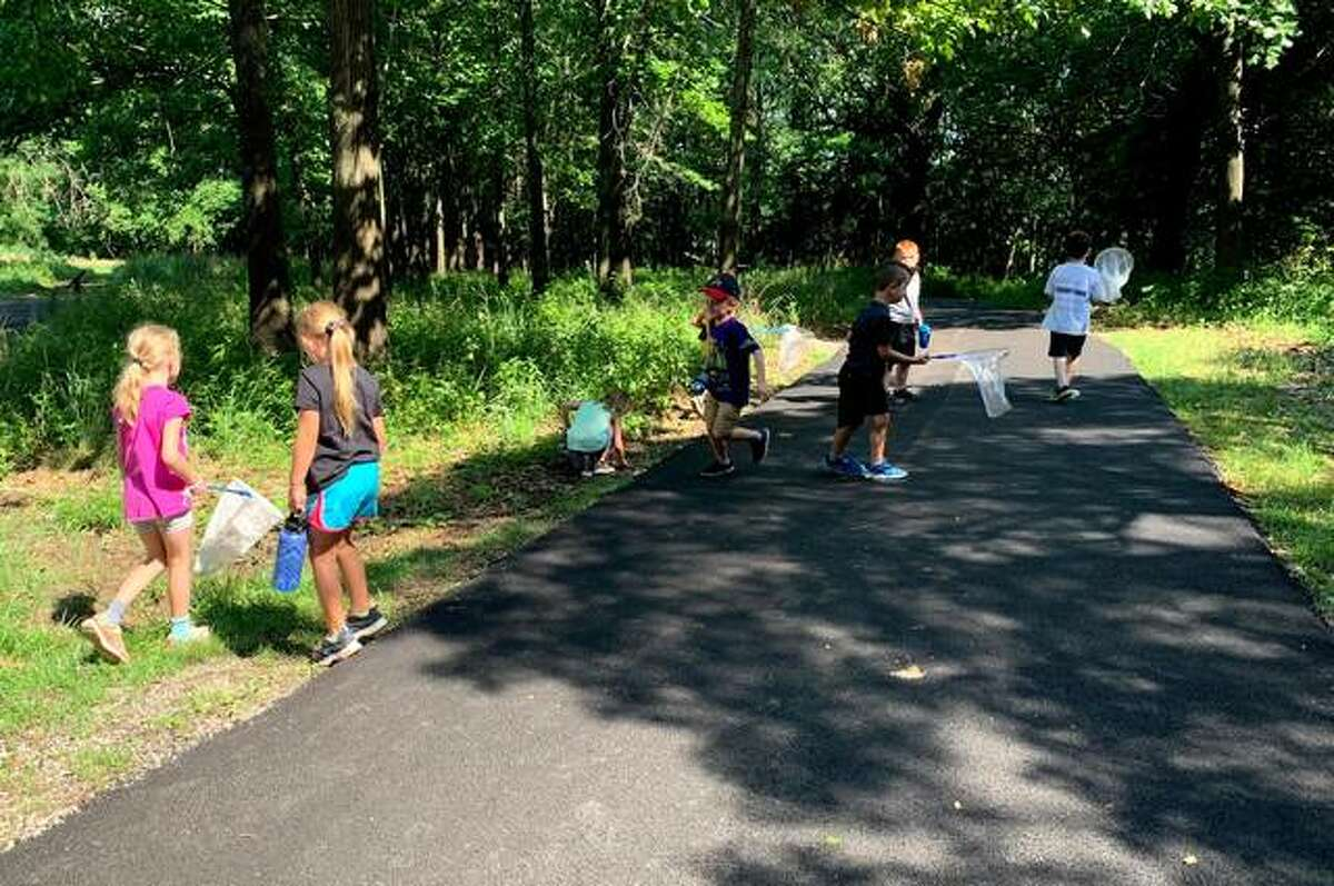 Children walking on new Frog Trail, a paved walking trail open for people of all abilities.