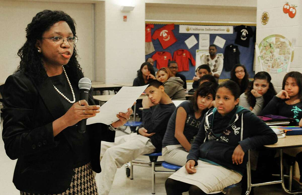 FILE PHOTO: Quinnipiac University professor Angela Robinson speaks to students at Mauro-Sheridan Interdistrict Magnet School in New Haven in 2019. Robinson gave a virtual presentation this week to more than 300 people this week on critical race theory.