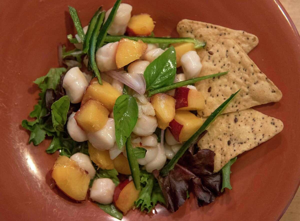 Scallop ceviche with fruit and spice prepared by Caroline Barrett.