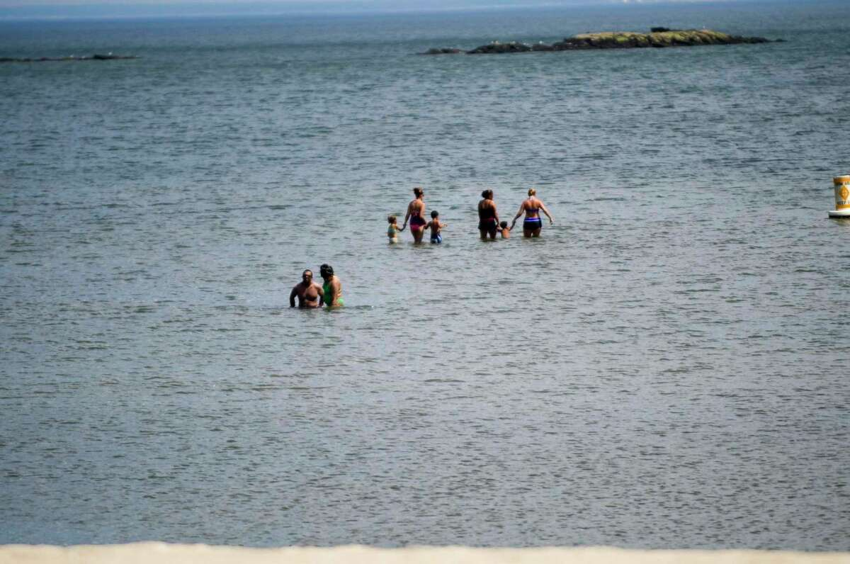 Cummings Beach offers relief as a heat wave drives temperatures up into the high 90s in Stamford recently.