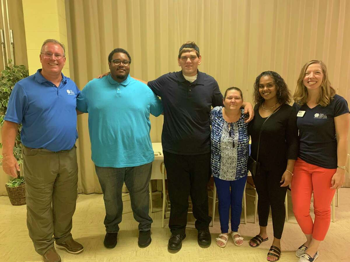 The four graduates are pictured with (far left) Mark Miller, the course instructor provided by The Legacy Center for Community Success, and (far right), Jennifer Majorana, director of adult literacy from The Legacy Center for Community Success. (Photo provided)