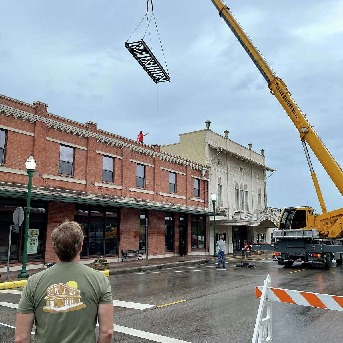 Tom Emmons, Fass Brewing CEO, looks on as the glycol chiller is install at Fass Brewing on Main Street in Conroe.
