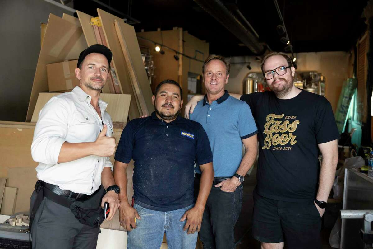 From left to right, David Marin, CEO of Iberica Construction, Jose Cardenas, Tom Emmons, CEO of Fass Brewing and Dylan Emmons, president and brewer, poses for a portrait at Fass Brewing in downtown Conroe, Thursday, Aug. 13, 2021. The brewery plans to open between mid and end of September.