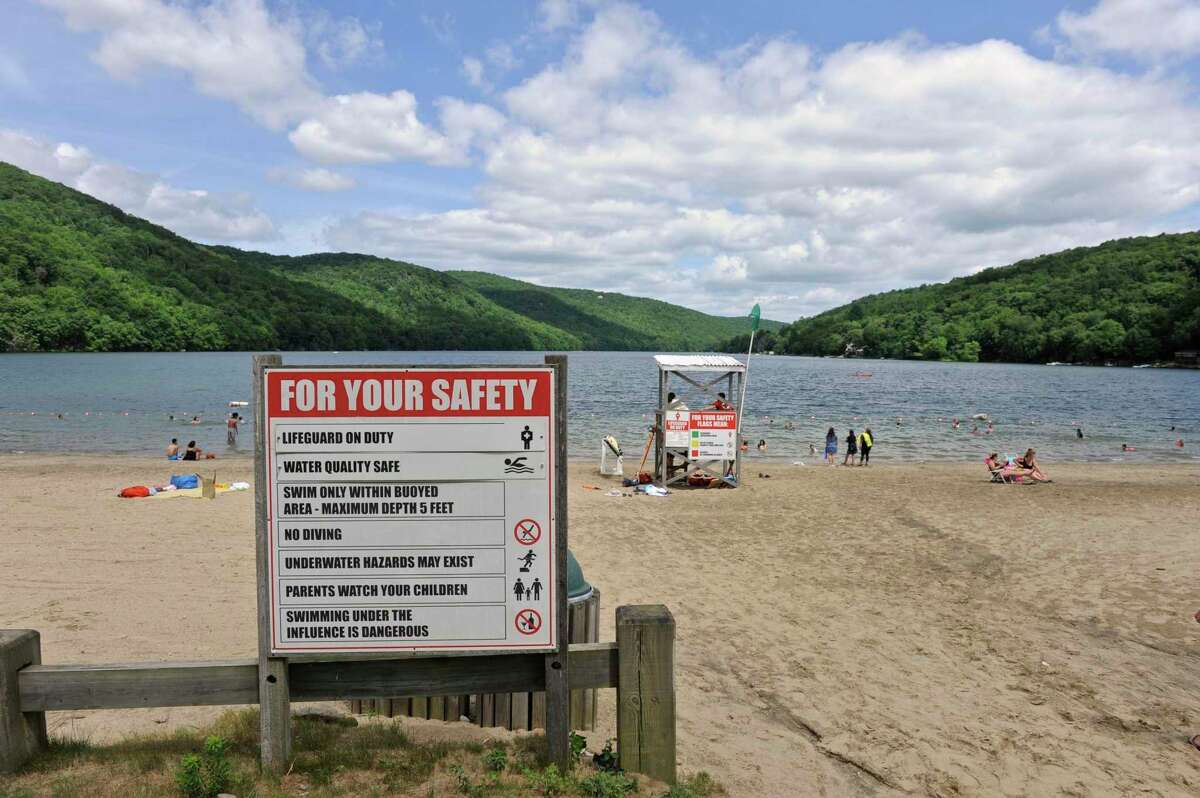 Squantz Pond State Park in New Fairfield, Conn., is among four state park inland beaches closed for water quality issues on Friday, Aug. 13, 2021.
