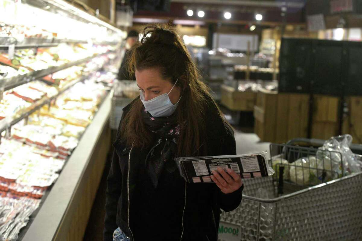 Debbie DiBlasi, of Sherman, wears a mask while shopping at Stew Leonard's today, less than 24 hours after the implementation of Gov. Ned Lamont's order directing masks to be worn in public setting where social distancing is not possible. Danbury, Conn. Tuesday, April 21, 2020.