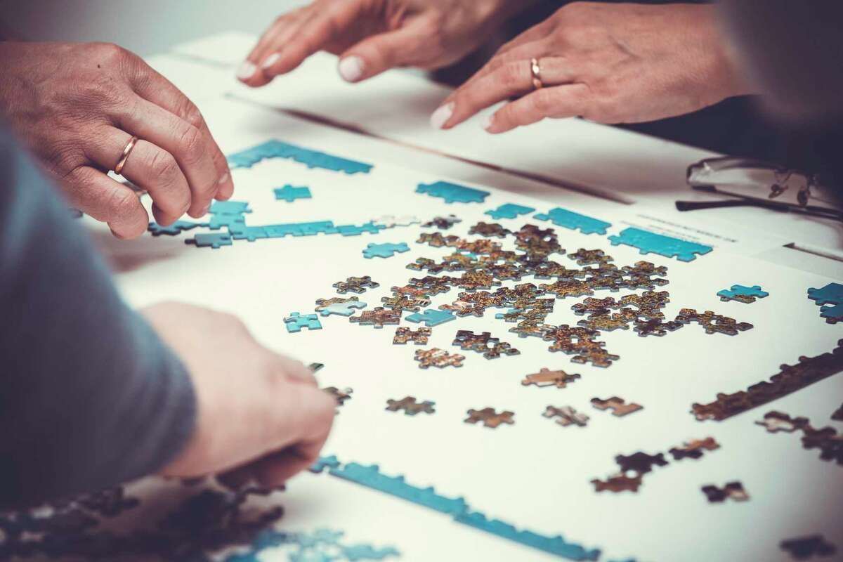 Working on puzzles. (Dreamstime/TNS)