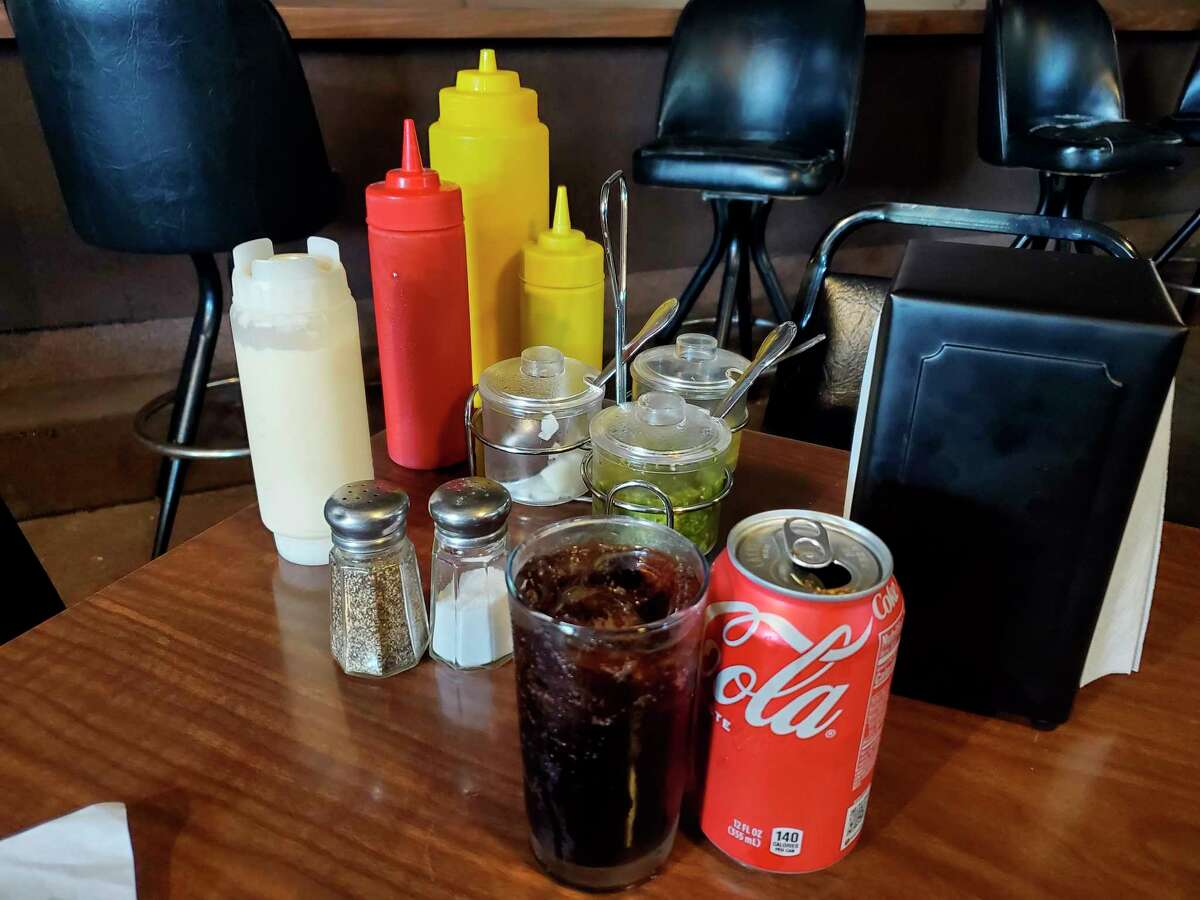 A burger order at Heck's Bar includes a small flight of topping and condiment options. (Scott Nunn/Huron Daily Tribune)