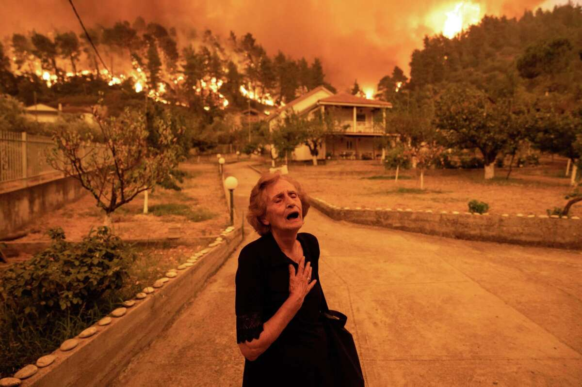 A resident in Greece flees a raging wildfire. A reader wonders how we can save the planet from warming if we can't even agree to wear masks during a pandemic.