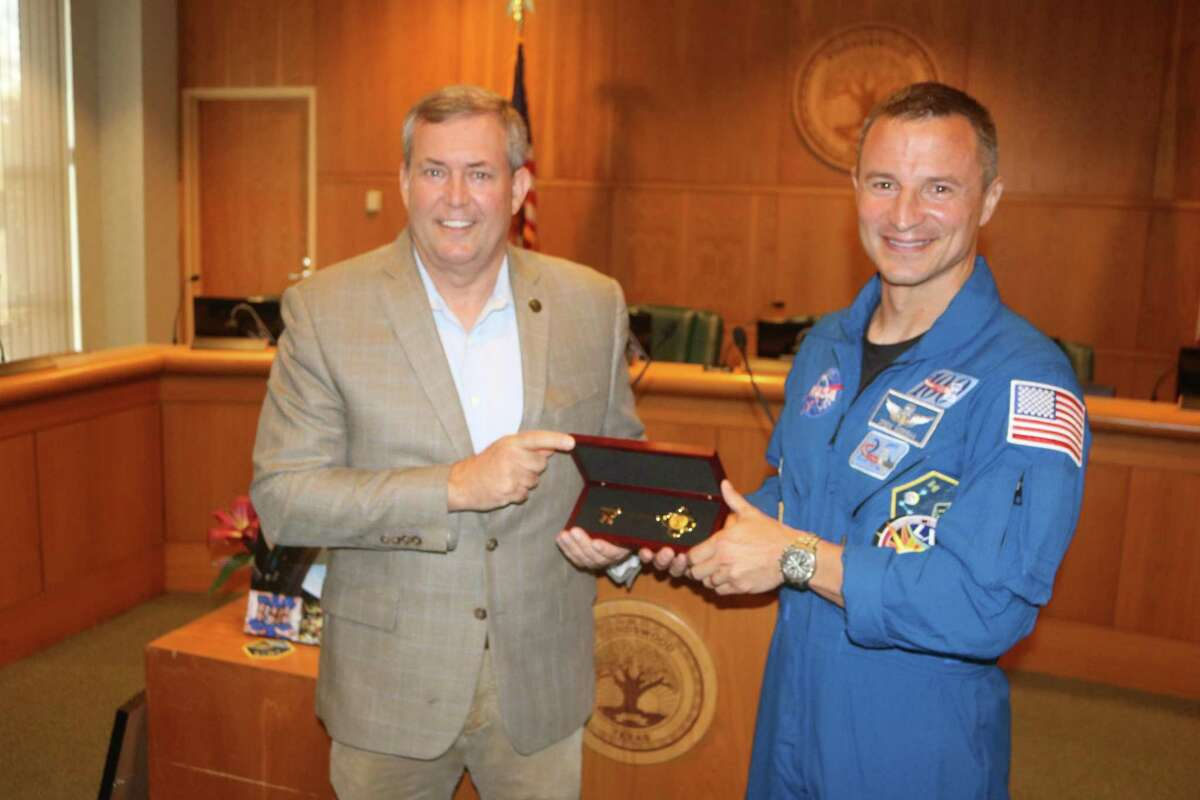 Friendswood Mayor Mike Foreman presents Army Col. Drew Morgan with the key to the city, honoring the Friendswood astronaut's work during his nine-month mission aboard the International Space Station.