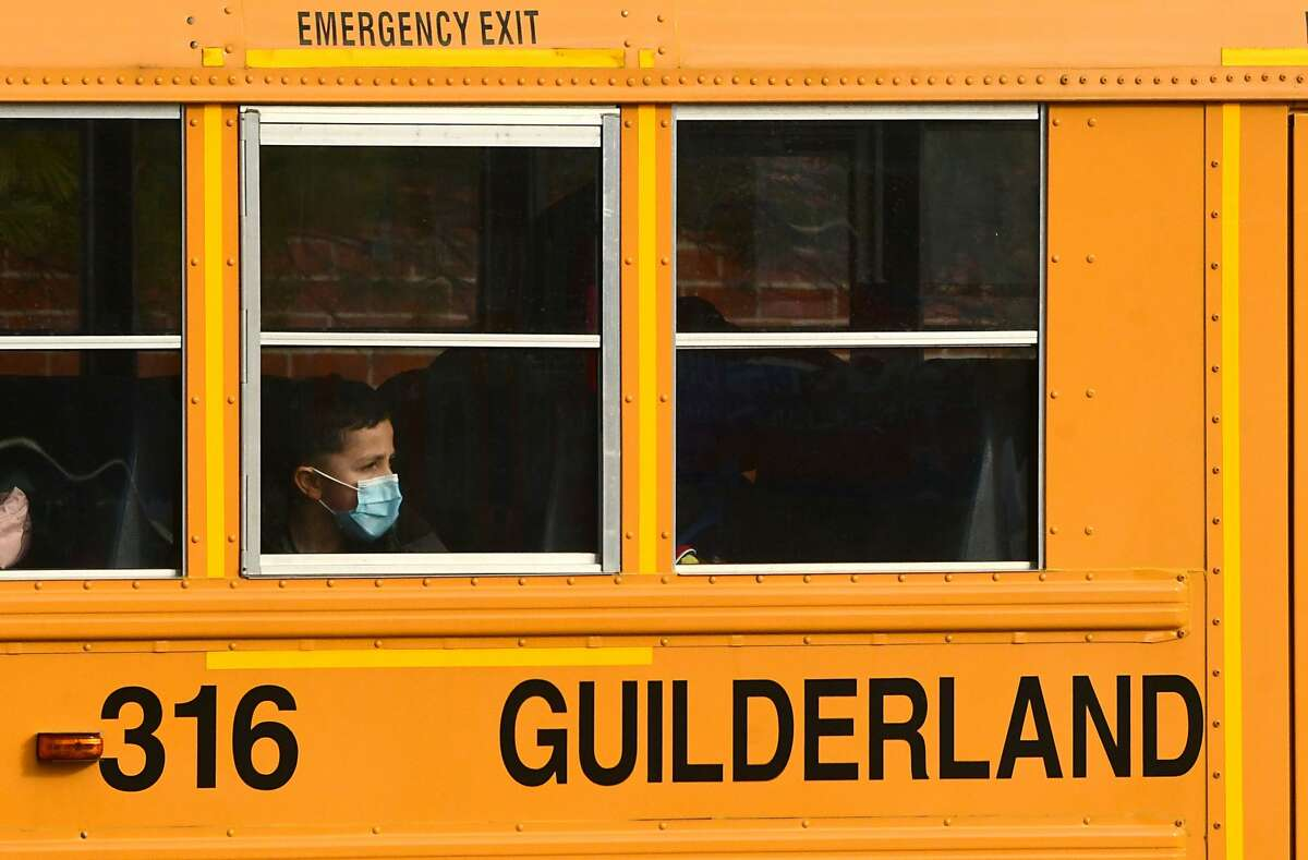 Students from Westmere Elementary in Guilderland ride the bus after school earlier this year.