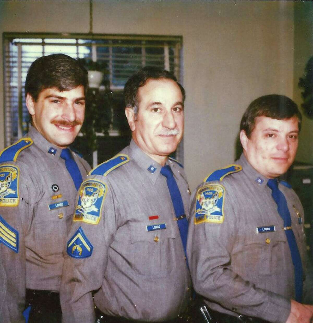 """Connecticut State Police Sgt. William """"Billy"""" Longo with the other two Longos at Troop C with Jerry in the center and Nick on the right."""