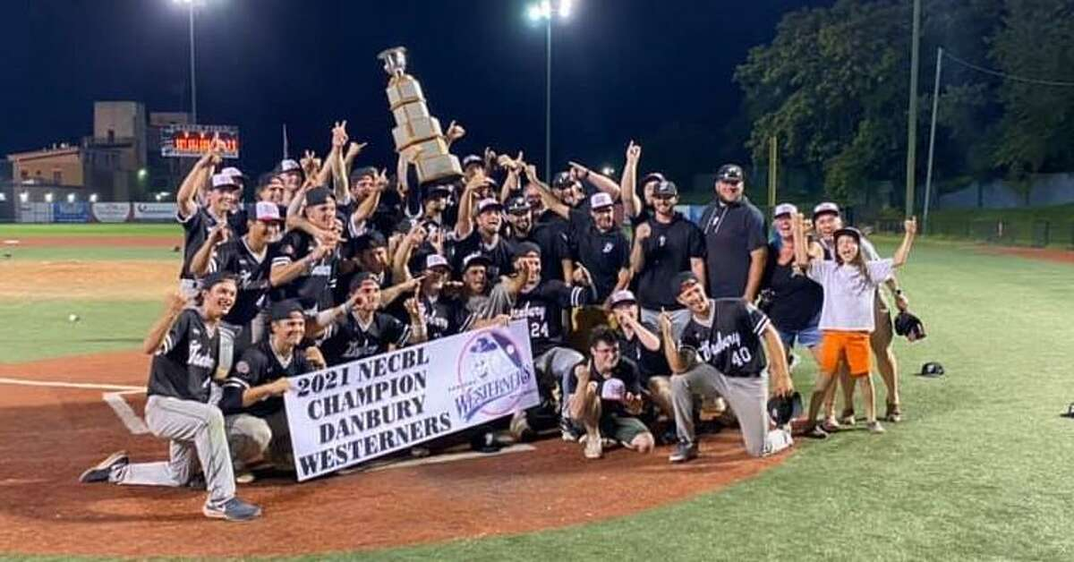 Danbury Westerners pose together after winning the New England Collegiate Baseball League title Thursday, Aug. 12 in Lynn, Mass.
