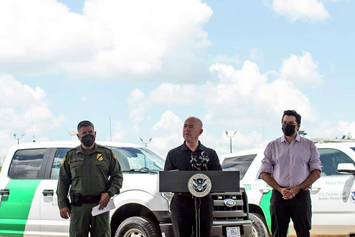 Homeland Security Secretary Alejandro Mayorkas, flanked by U.S. Border Patrol Chief Raul Ortiz and DHS Chief Medical Officer Pritesh Gandhi.