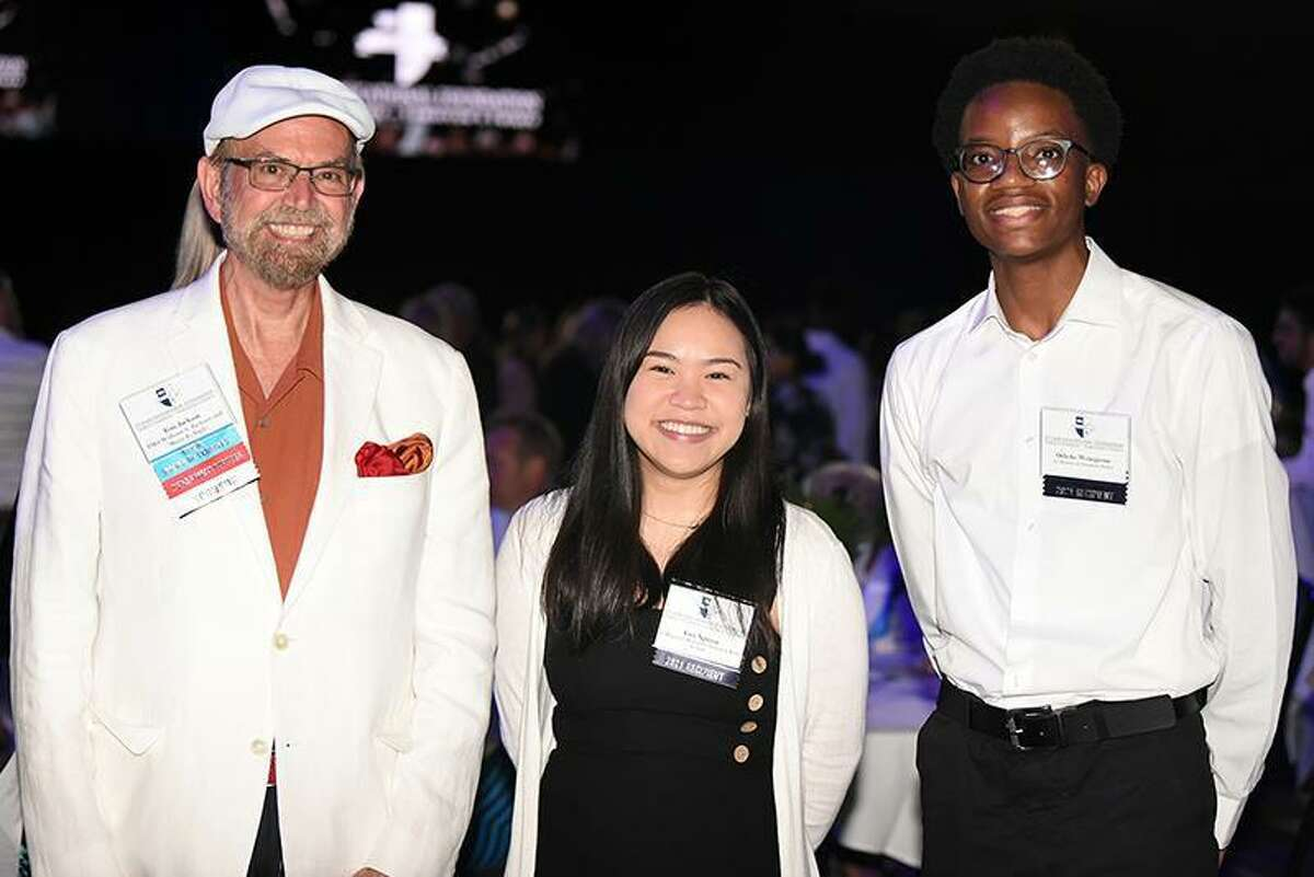From left, Tom Jackson, CFISD Board of Trustees member, Vivi Nguyen, Cypress Ridge High School graduate and Oshoke Wenegieme, Cypress Creek High School graduate, pose for a photo at the 2021 CFEF Scholarship Reception, held Aug. 3 at the Berry Center. This year's reception celebrated 143 recipients, who shared more than $681,000 in scholarship awards.