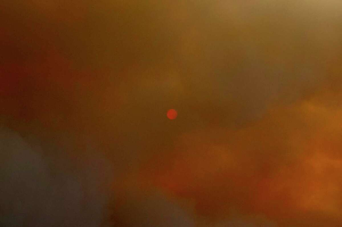 The sun on Wallace Creek Road west of Healdsburg is blocked by large plumes of smoke from the Walbridge Fire in Sonoma County last August.