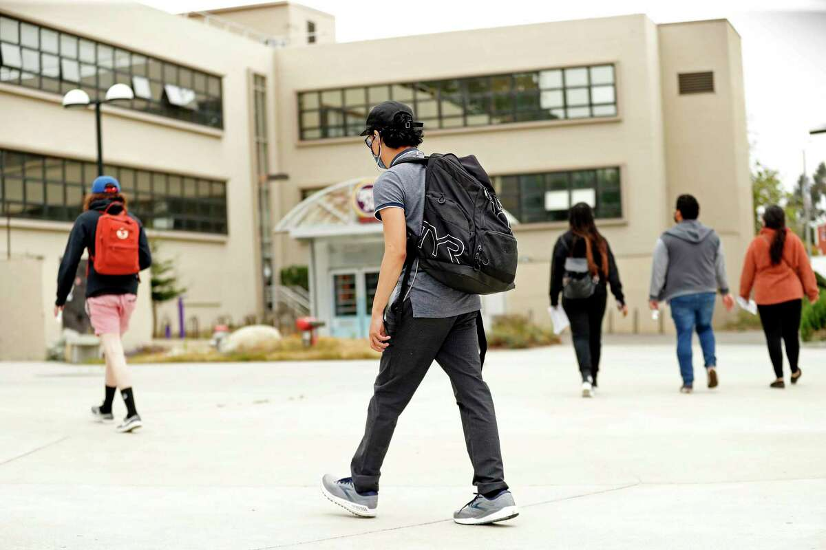 On Thursday, a week before the academic semester begins, young people walk on campus at San Francisco State University. San Francisco State University is among the California campuses that have hired vendors to scrutinize vaccination cards for signs of anything amiss, amid worries about fakery.