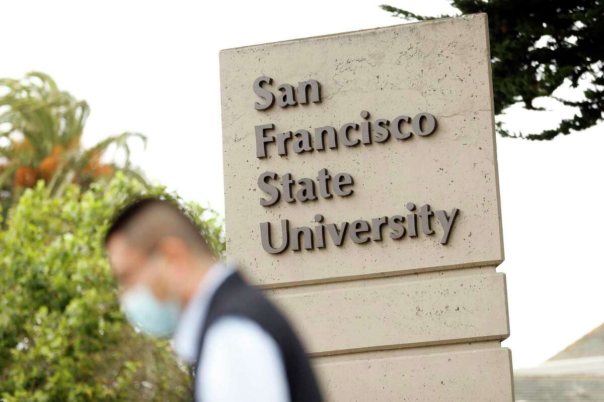 """A man leaves campus at San Francisco State University in San Francisco, Calif. San Francisco State University officials warned students and staff to avoid campus until 10 a.m. Tuesday, citing an ongoing police investigation into """"an anonymous, non-specific threat."""""""