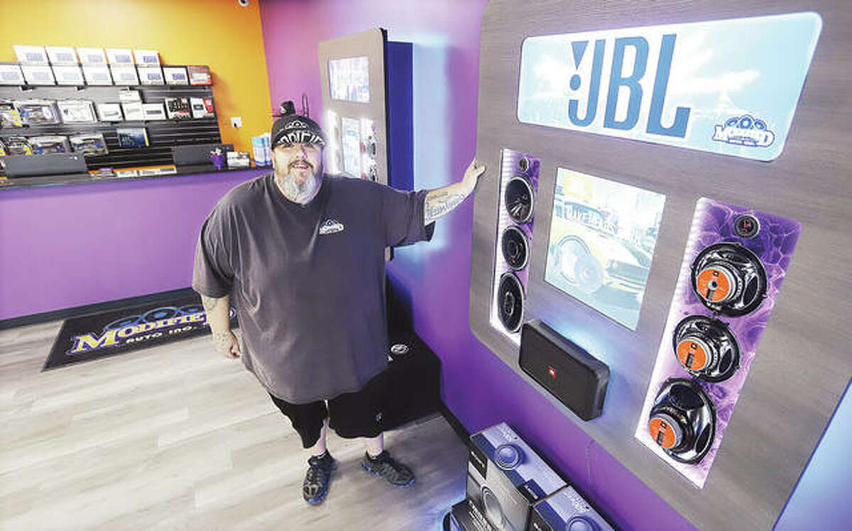 Owner Shawn Fowler stands inside the new Modified Auto Inc., at 241 Eastgate Plaza, in East Alton. Modified Auto moved to Eastgate from a previous East Alton location where it had grown exponentially over seven years. The shop opened at the plaza on Aug. 9. - John Badman|The Telegraph