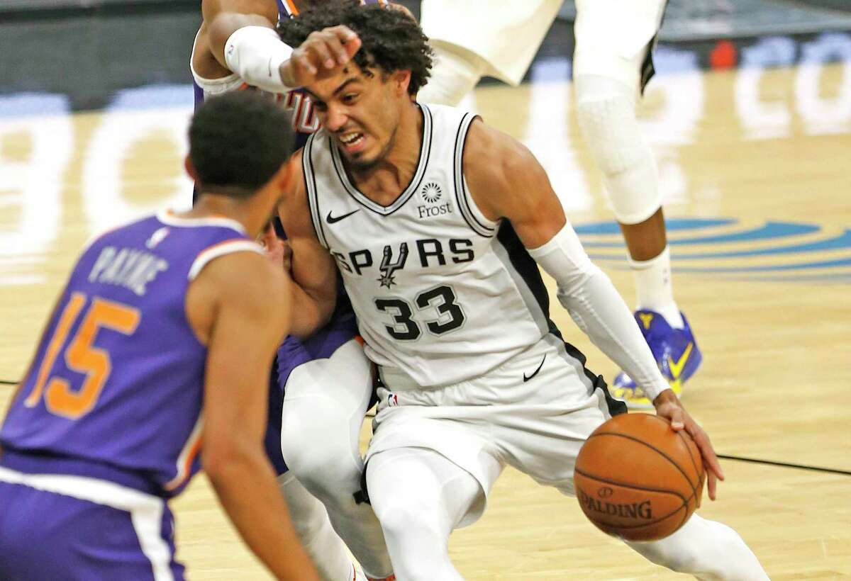 SAN ANTONIO, TX - MAY 15: Tre Jones #33 of the San Antonio Spurs drives against Langston Galloway #2 of the Phoenix Suns in the second half at AT&T Center on May 15, 2021 in San Antonio, Texas. NOTE TO USER: User expressly acknowledges and agrees that , by downloading and or using this photograph, User is consenting to the terms and conditions of the Getty Images License Agreement. (Photo by Ronald Cortes/Getty Images)