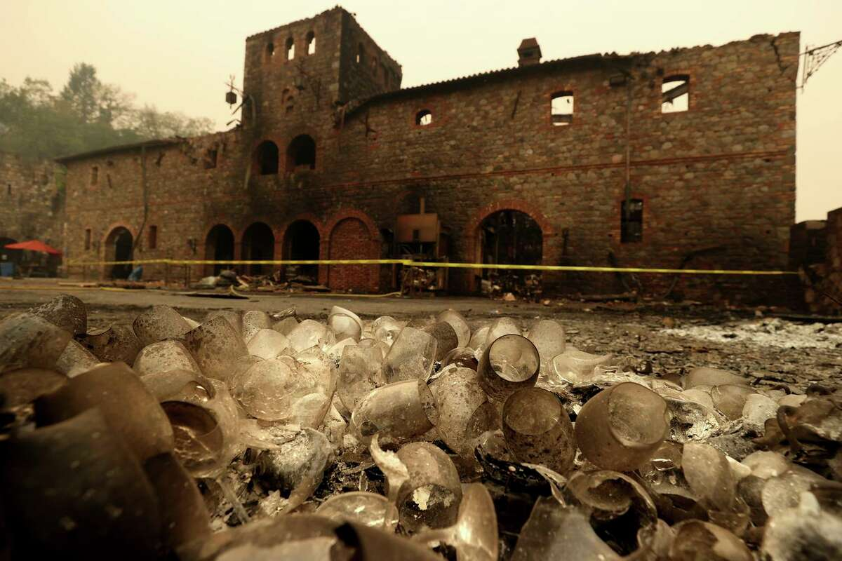 Burned wineglasses sit in a pile in front of a building at Castello di Amorosa that was destroyed by the Glass Fire on Oct. 1 in Calistoga. The fire burned more than 67,000 acres and destroyed 1,555 structures.