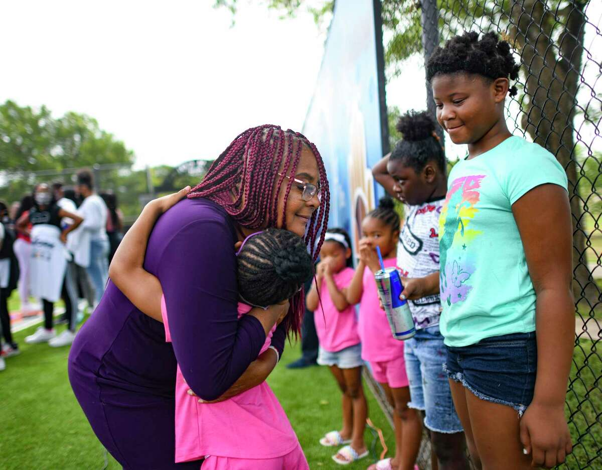 """Laura Thompson of TAAN-TV embraces Laini Simmons during the launch of the """"Work is the New Hustle"""" program at the Eastside Boys & Girls Club in June. New 2020 census numbers just released show that San Antonio's population is becoming more racially and ethnically diverse."""