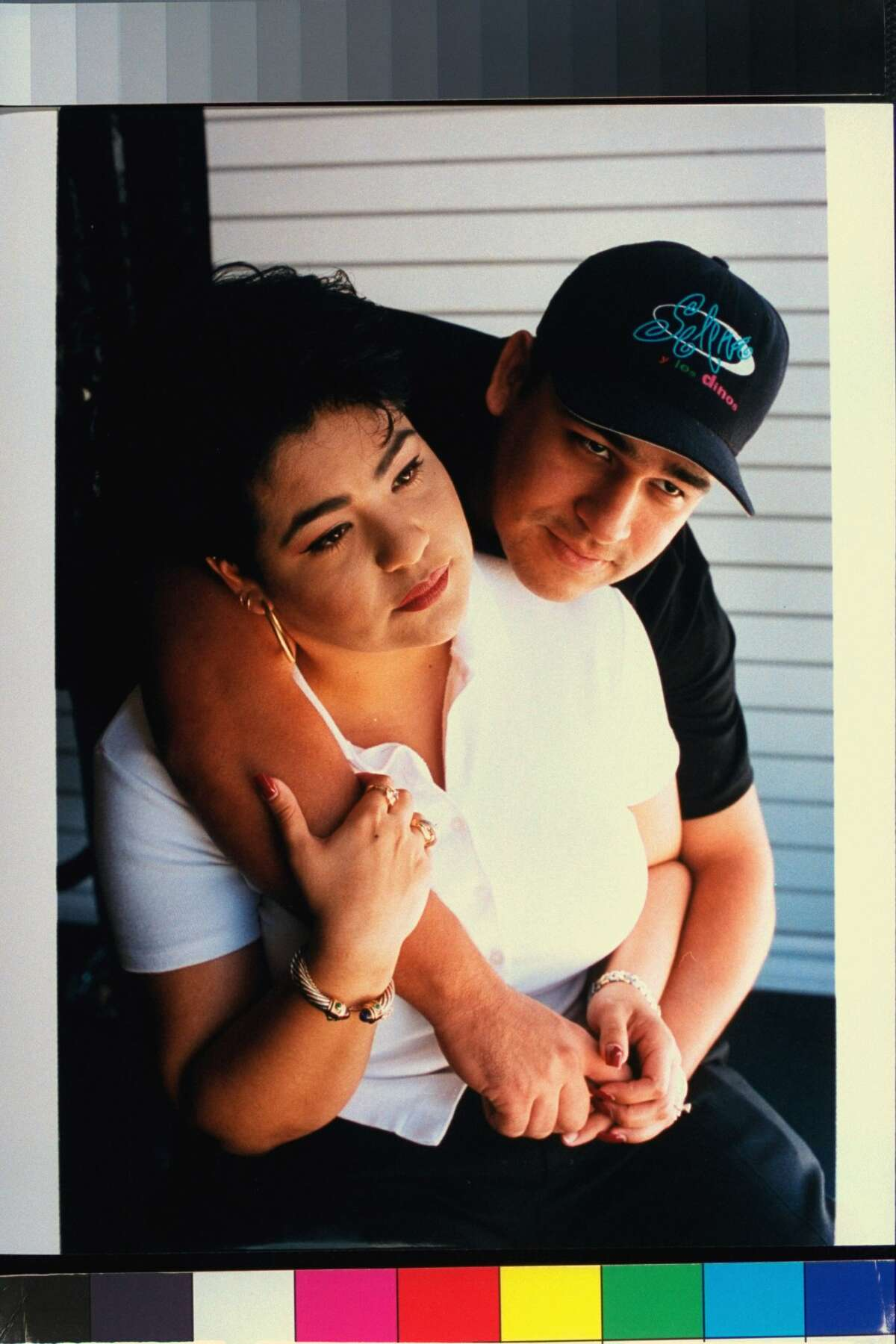 Chris Perez, husband of slain tejano singer Selena, posing w. arms around her sister Suzette Quintanilla. (Photo by Barbara Laing/Getty Images)