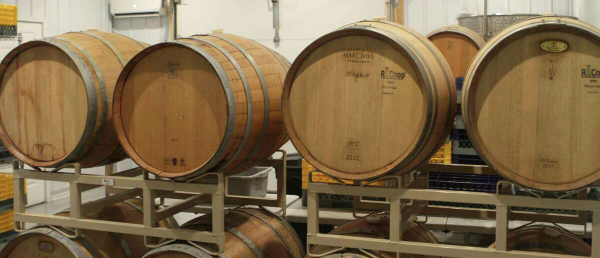 All wine sold at Young's Farm is barreled and aged for 18 months before it's bottled and sold to customers. (Pioneer photo/Joe Judd)
