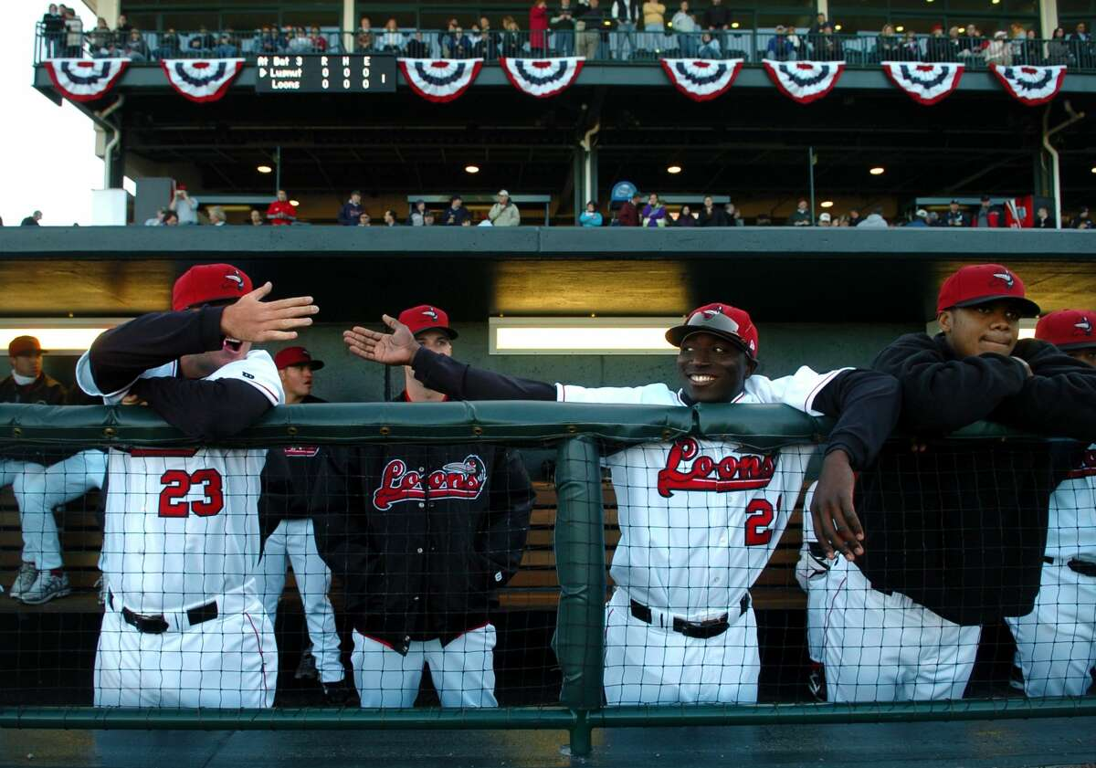 Loons pitcher Doug Brooks, left, fives outfielder Trayvon Robinson in the team's dugout before the start of Friday night's game. The Loons played before a sold out crowd for their first home game in franchise history. (Daily News file/Brett Marshall)