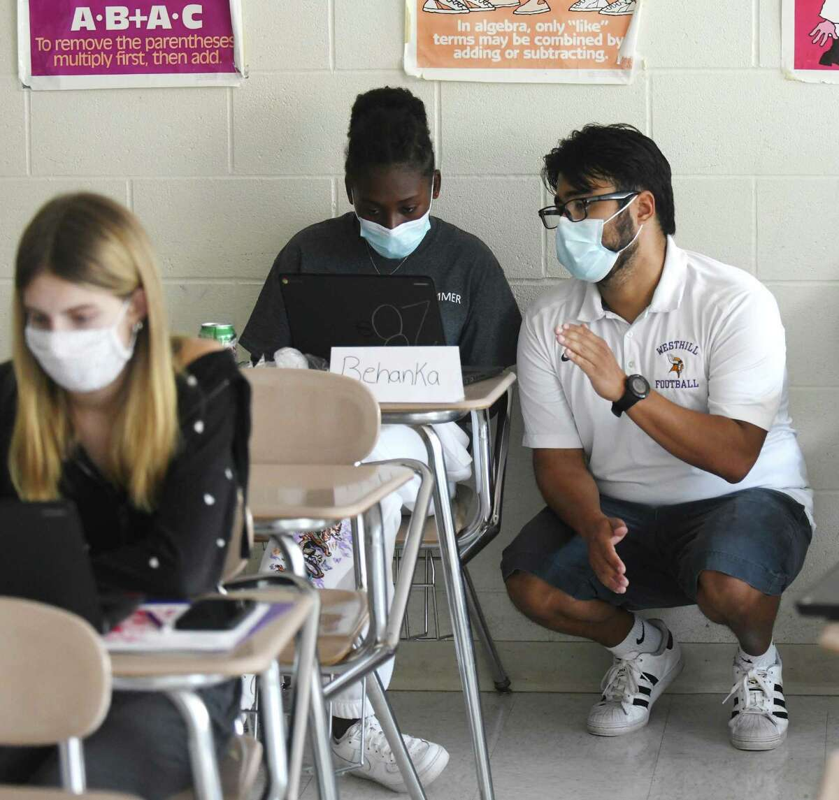 Instructor Owen Sandoval helps rising senior Behanka Adonis fine tune her college application personal statement at the College Prep Academy at Westhill High School in Stamford, Conn. Wednesday, Aug. 11, 2021. The three day program helps rising seniors find the right college fit and teaches tips on how to apply, write an essay, apply for financial aid, and more.