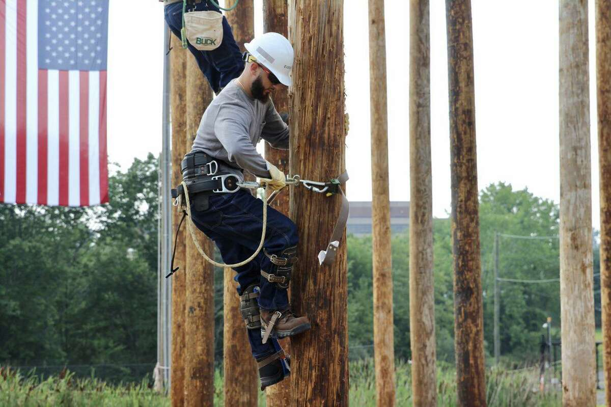 Jared Vasquez of Stratford practices his utility pole climbing skills as part of an 11-week certification course offered by Capital Community College in Hartford. The school is offering the program in partnership with Eversource Energy and the International Brotherhood of Electrical Workers Local Unions 420 and 457.