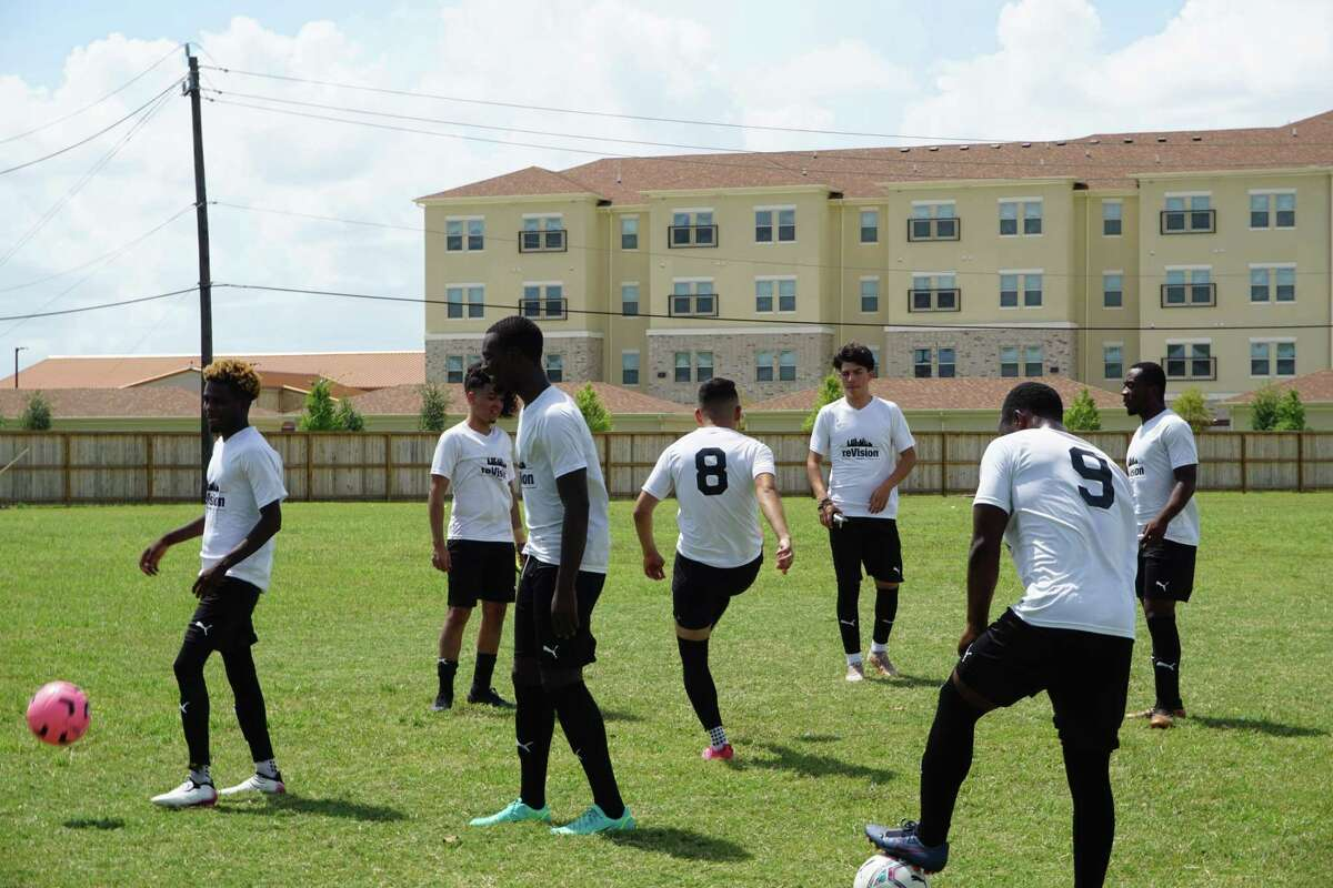 Members of the reVision Houston FC soccer team from the Gulfton area of southwest Houston warm up ahead of their last game together on Sunday, Aug. 8, at Roane Park in Missouri City. The team has 24 players who are all both immigrants and first-generation college students.
