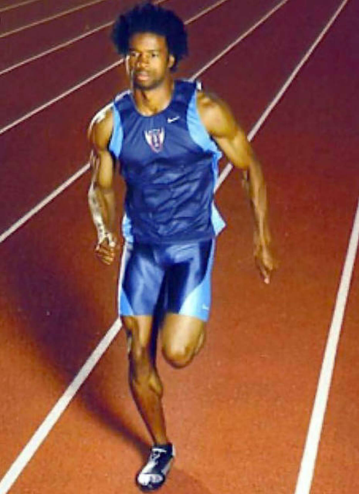 Babatunde Ridley, the superstar of the 1996 IHSA boys track championship won by Carlinville High School, is shown in his later athletic career. Ridley captured four individual state titles in 1996, accounting for 40 of Carlinville's 46 team points.