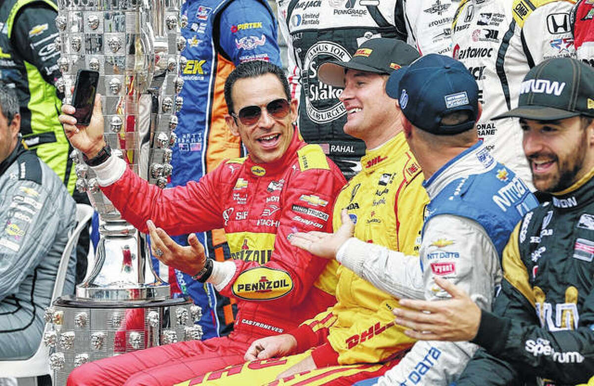Ryan Hunter-Reay, center, and Tony Kanaan, right, joke with Helio Castroneves, left, before the final practice session for the 2016 Indianapolis 500. Hunter-Reay and Kanaan are two of the seven former Indy 500 champs who will race in this year's Bommarito 500 at Worldwide Technology Raceway in Madison.
