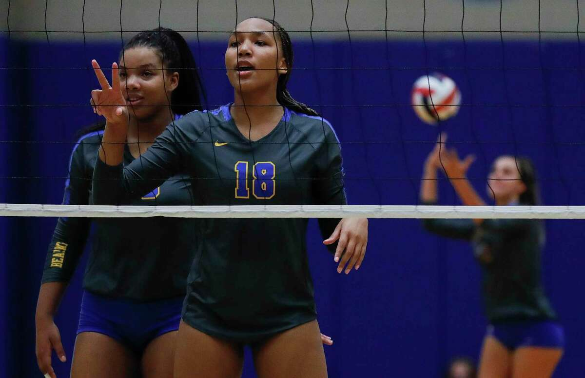 Klein outside hitter Mikala Sampson (18) calls out The Woodlands defense during the first set of a non-district high school volleyball match at Klein High School, Saturday, Oct. 10, 2020, in Spring.