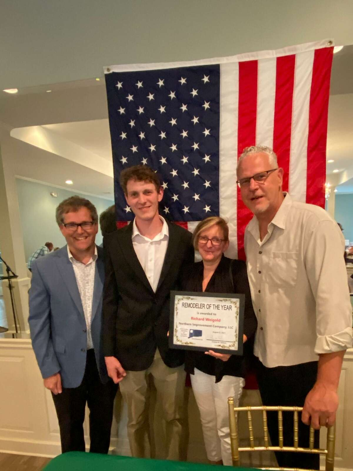 The Home Builder Association of Northwest CT joined the Litchfield County Chapter of the Greater Hartford Association of Realtors to honor Remodeler of the Year Northern Improvement Company of Torrington. From left are Steve Temkin and owners Mason, Cara and Richard Weigold.