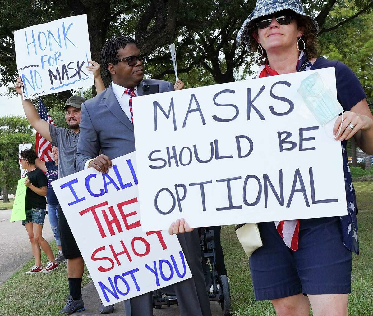 Anti-mask demonstrators outside Houston Intermediate School District building before it holds a meeting about having a mask mandate in Houston on Thursday, Aug. 12, 2021.
