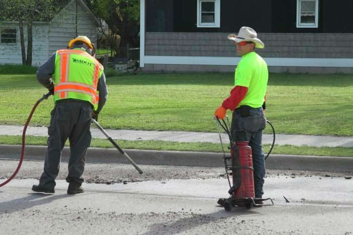 In this file photo, Michigan Department of Transportationcrew membersperform crack seal work on the southern end of U.S. 31 in the City of Manistee. This week, the U.S. Senate adopted a $1 trillion infrastructure bill that includes $550 billion in new revenue for roads, water systems, electric vehicle charging, broadband, rail and transit. Michigan would see about a 30% increase in federal aid to roads over the five-year period if the bill clears the House. (File photo)
