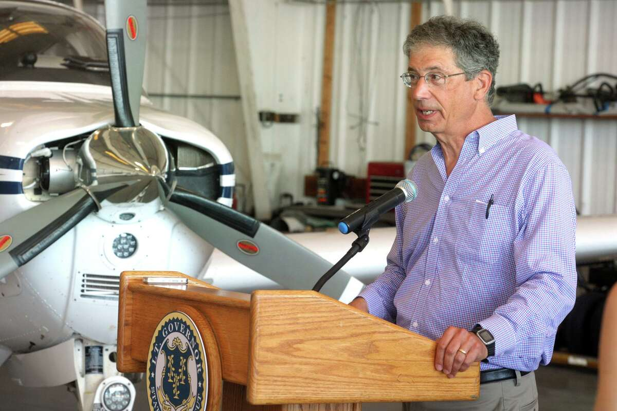 Aaron Hollander, Chairman and Chief Executive Officer of First Aviation, speaks at news conference at Sikorsky Memorial Airport, in Stratford, Conn. July 21, 2020. It was announced that manufacturing students from Bassick High School, in Bridgeport, will soon begin building a RV-12 airplane.