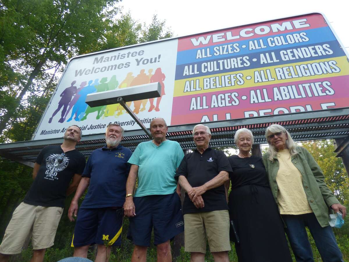 """Members of the Manistee Area Racial Justice and Diversity Initiative sponsored this sign along U.S. 31, south of Manistee, which welcomes """"all people"""" to the county."""
