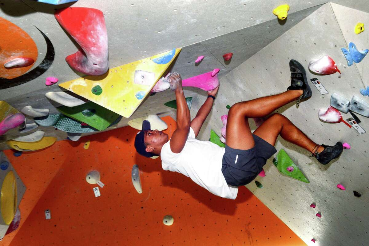 Maurice Neri, of Stratford, practices his climbing and bouldering skills at Rock Climb Fairfield, in Fairfield, Conn. Aug. 13, 2021.