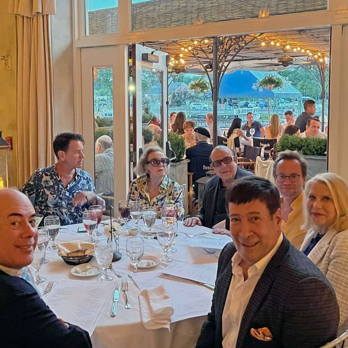 Bedford, N.Y. resident and music mogul Clive Davis dines at L'Escale at the Delamar in Greenwich last weekend with WOR radio host Mark Simone; woman's rights activist/philanthropist Francine LeFrak; director/screenwriter Rick Friedberg; and interior designer Greg Schriefer.
