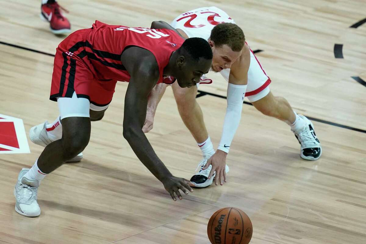 Usman Garuba and Toronto's Malachi Flynn scramble for a loose ball during the second half of an NBA summer league basketball game.