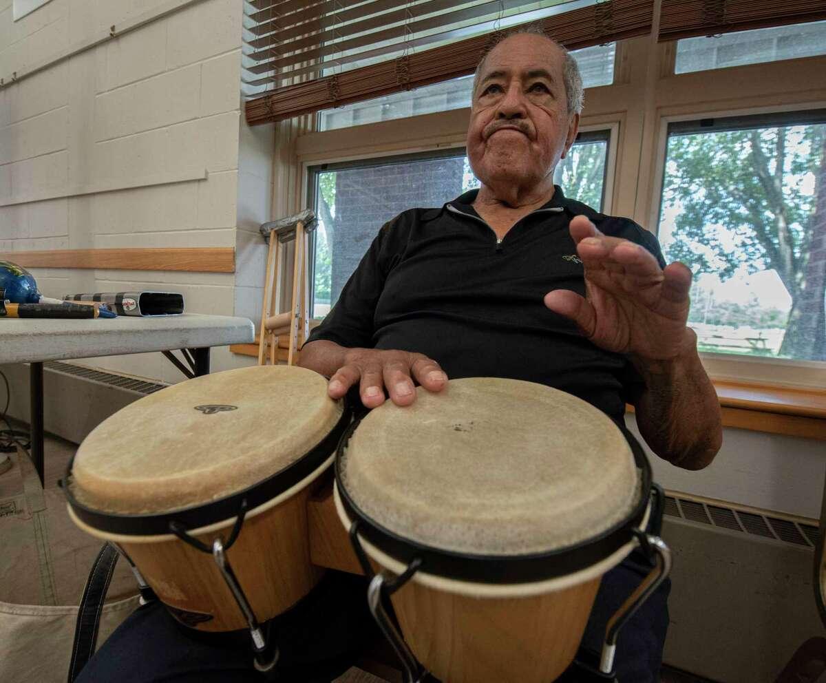 Raoul Nunez, 92, plays the bongos as Ray Nunez teaches seniors in Latin dancing at the Clifton Park Senior Center on Friday, Aug. 13, 2021 in Clifton Park, N.Y.