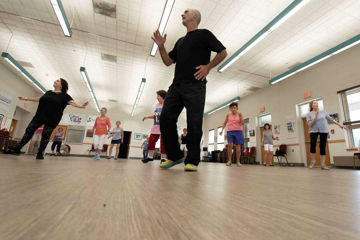 Ray Nunez teaches seniors in Latin dancing at the Clifton Park Senior Center on Friday, Aug. 13, 2021 in Clifton Park, N.Y.