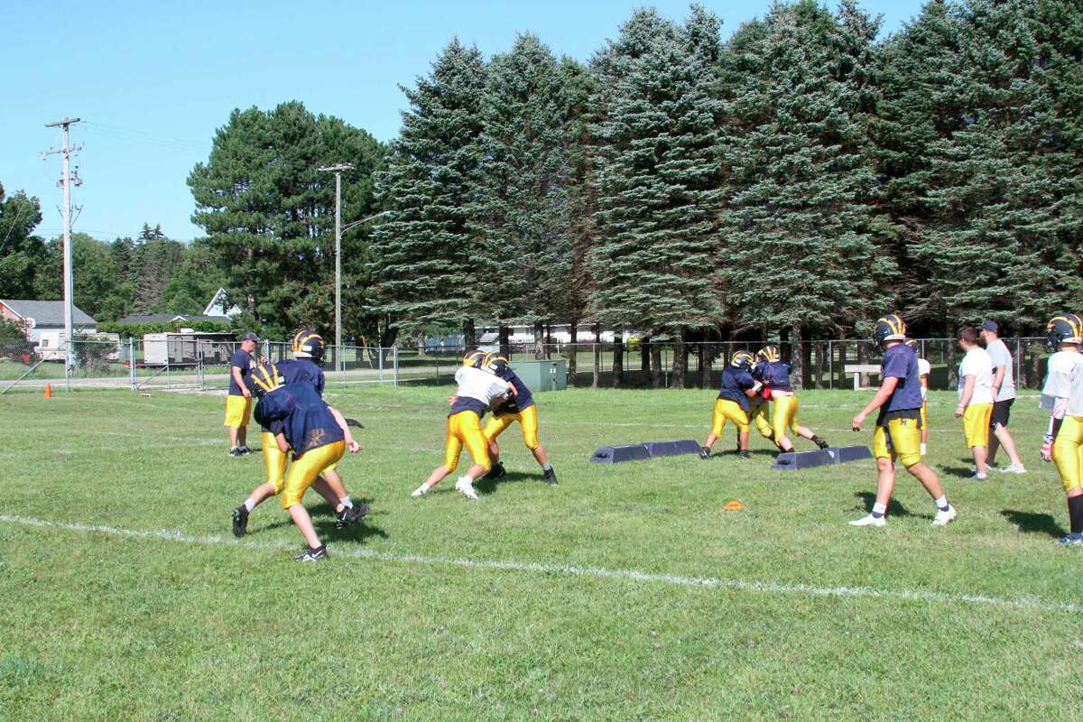 The Manistee High School football team runs drills with its offense and defense on Friday afternoon. (McLain Moberg/News Advocate)