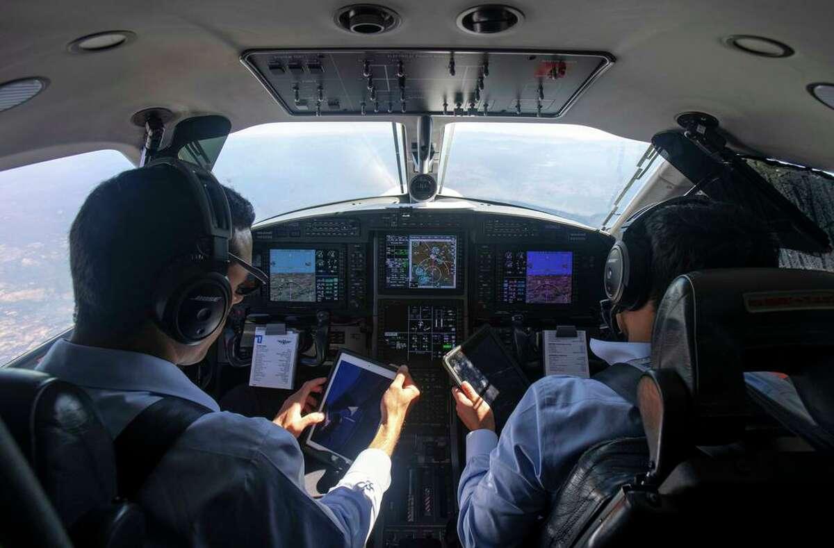 SurfAir pilot Eldar Sela (left) and First Officer Mortimer Howard in flight from San Carlos to Truckee Tahoe Airport.